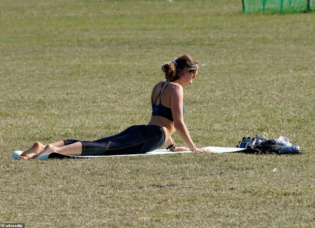 Britons are set to bask in 84F heat while temperatures soar and are set to make a perfect weekend before the rain is due to sweep in next week. Pictured: A woman enjoys the sun on Clapham Common
