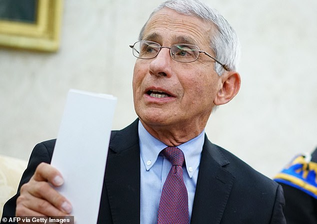 Fauci is pictured during a meeting with Trump in the Oval Office earlier this year as the outbreak was beginning to spread aross the US