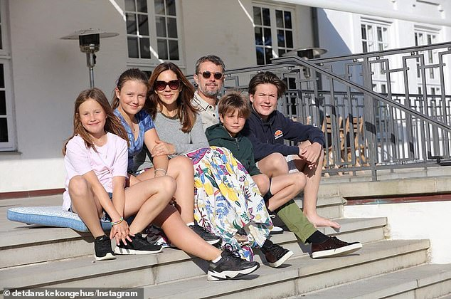 Family time: In one of the photos, Frederik, 52, Mary, 48 and their children, Prince Christian, 14, Princess Isabella, 13, Princess Josephine, 9, and Prince Vincent, 9, all sat together