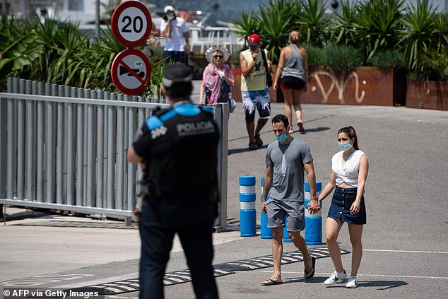 Police monitored the streets of Barcelona habour as gatherings of 10 people were banned by the regional government
