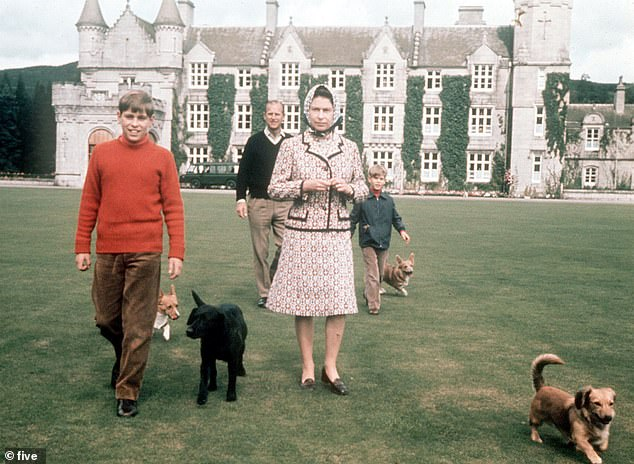 The Royals at Balmoral back in 2003, with their pet dogs walking in the grounds
