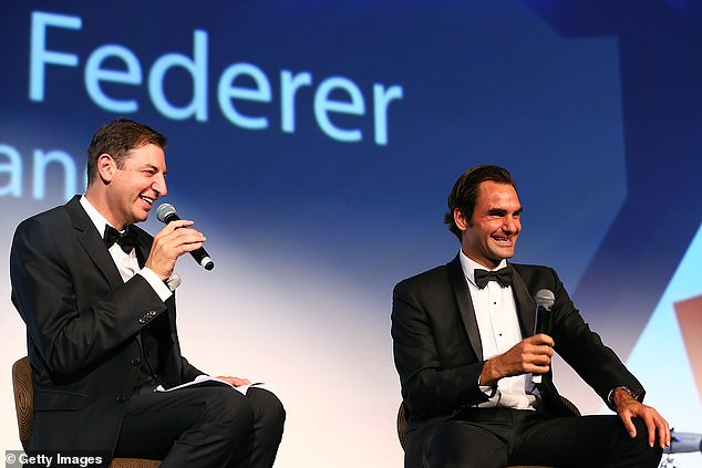 Hard at work: Basil will continue working in his various media roles, including as a sports anchor on Seven, a morning radio show on 6PR and a column in The West Australian. Pictured with Roger Federer at the Hopman Cup New Year's Eve Gala