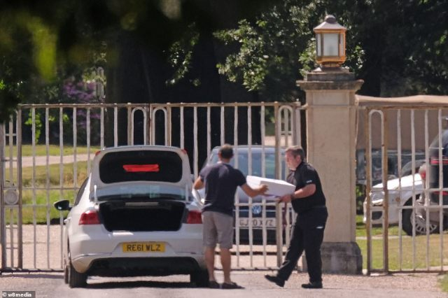 Flowers and boxes were being unloaded from vehicles outside the gates of the park following the wedding earlier in the day
