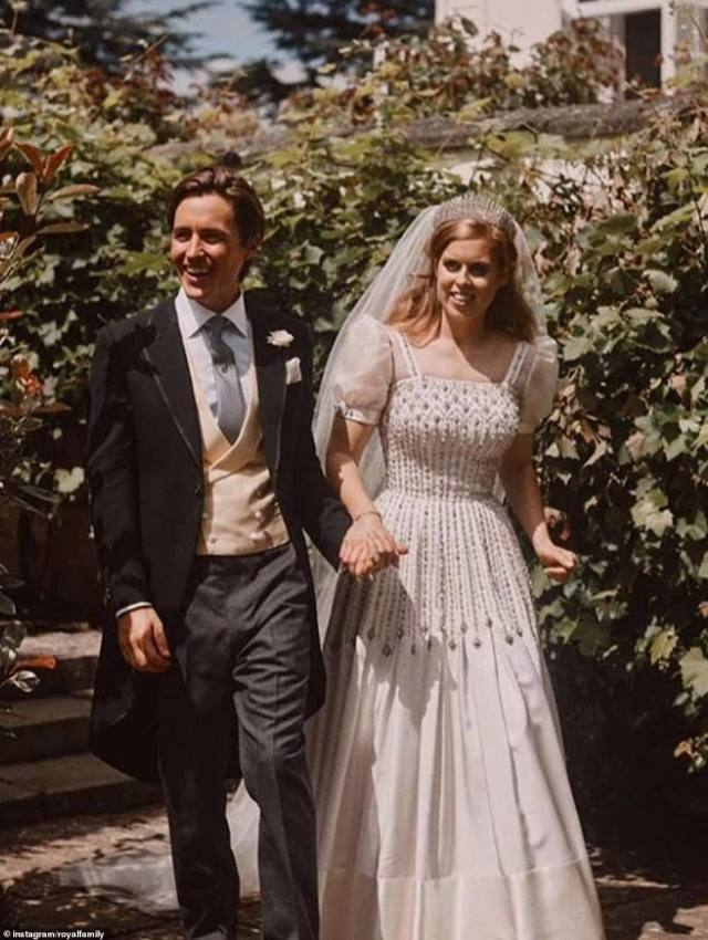 In one of the new photographs, the happy couple can be seen holding hands and beaming as they walk through the grounds of the Royal Lodge (pictured)