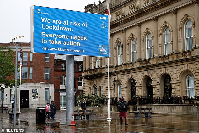 The borough of Blackburn with Darwen in Lancashire has a rate of 79.2 Covid-19 cases per 100,000 in the seven days to July 17, according to the latest data from Public Health England (PHE). Pictured: a warning sign in Blackburn town centre