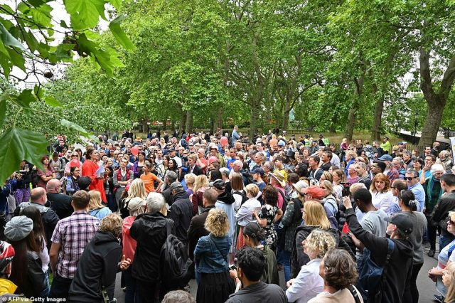 Hundreds appear not to abide by social distancing rules as they packed into a road in Hyde Park during Sunday's protest