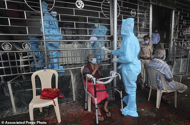 India (health workers are seen treating patients), which has now confirmed more than 1 million infections, on Sunday reported a 24-hour record of 38,902 new cases