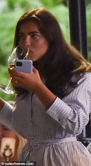 Stylish: Francesca let her lengthy brunette tresses flow loosely and she finished the look with a pair of white trainers