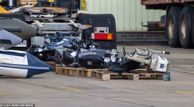 A number of engines from the various vessels can be seen on wooden pallets near the facility in Kent