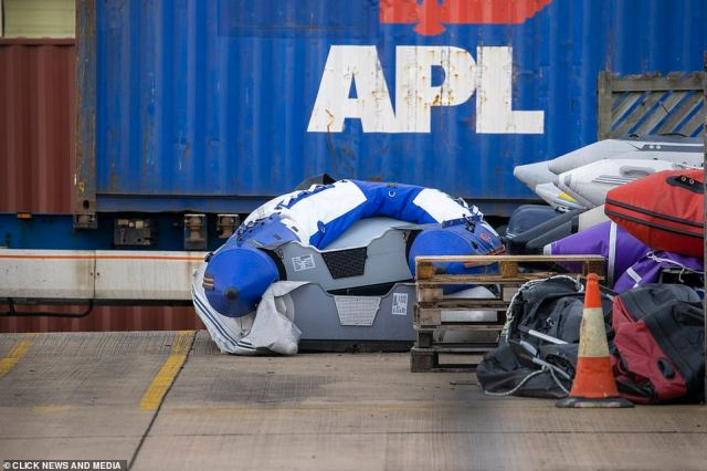 A crushed dinghy sits alongside others at the facility in Dover, Kent. The recent crossings are thought to be due to the recent good weather and clearing out of a migrant camp by authorities in France
