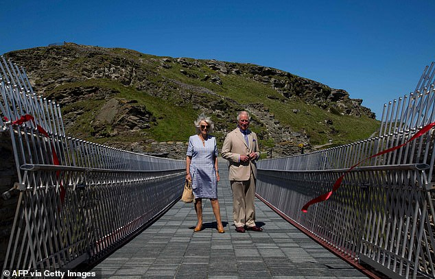 The couple beamed while posing for a photograph after officially opening the Tintagel bridge, which isset over a 190ft gorge