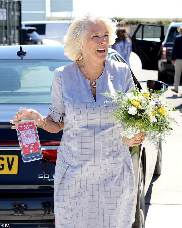 The Duchess of Cornwall, who was gifted a bottle of gin and a posey of flowers during her visit, appeared unfazed by the emergency