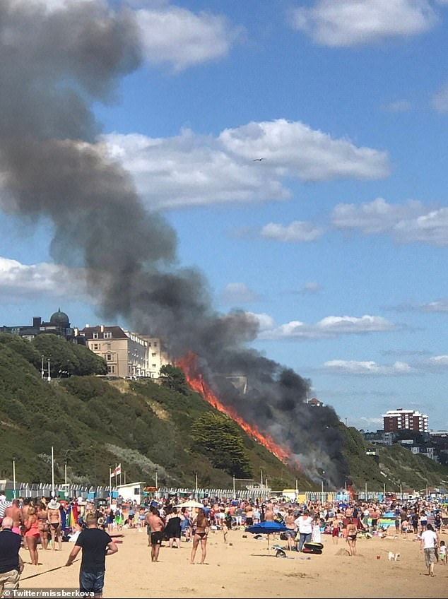 A huge fire has erupted on Bournemouth beach, where crowds of sun-seekers are enjoying the warm weather