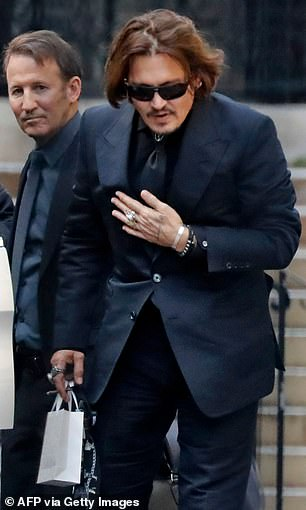 From the first kiss to the last quarrel, it was hardly a failure in the space-time continuum, writes JAN MOIR.  Pictured: Depp in court today