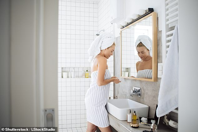 A 29-year-old woman has revealed how she was convinced her husband was cheating on her after finding long strands of hair in their bathroom (stock image)