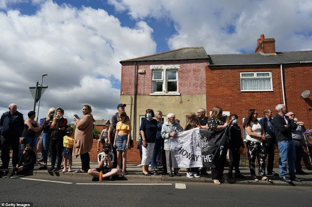 People line the streets to pay tribute to Jack Charlton ahead of his funeral procession today in Ashington, Northumberland