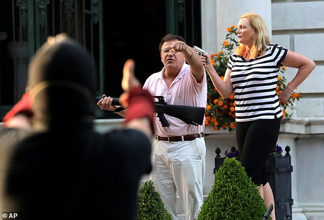 Mark and Patricia McCloskey, who live in the Forest Park area of St. Louis, brandished their firearms at protesters marching past their mansion in their gated community