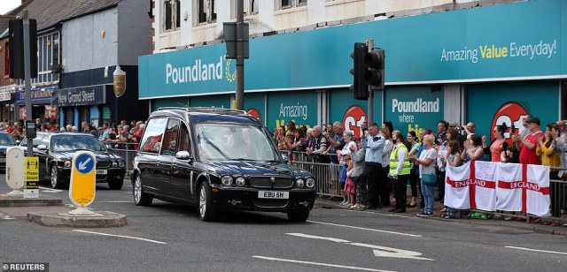 People watch the funeral procession to remember Jack Charlton today in his hometown of Ashington, Northumberland