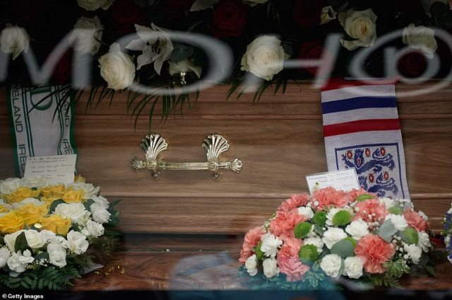 A close-up of the flower tributes for Jack Charlton as his funeral cortege passes through his childhood hometown today