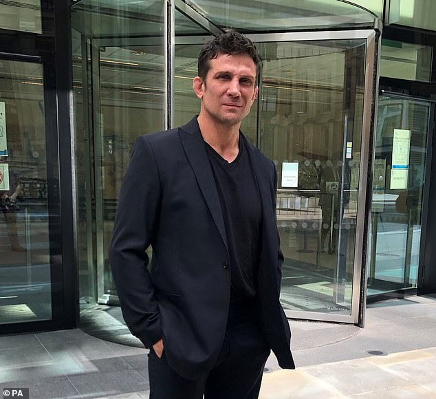 Alex Reid, former husband of Price, stands outside the Rolls Building in London today