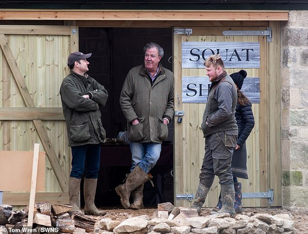 Jeremy Clarkson chats to locals at his Diddly Squat farm shop in Chipping Norton, Oxfordshire