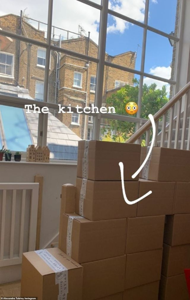 Alexandra shared a wistful picture of the piles of boxes in her home with a shocked face