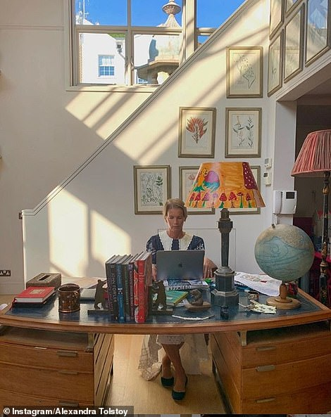 The Countess at work at her desk, giving a talk to pupils at her alma mater Downe House
