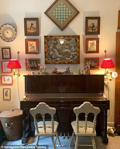 Alexandra recently put the upright Yamaha piano her children practice on up for sale. A snap shared to Instagram reveals walls decorated with a display of taxidermy butterflies and cute wooden figurines perched on top