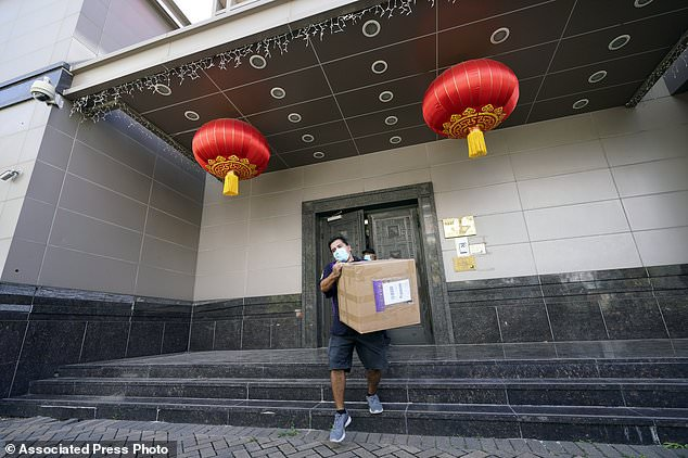 On Tuesday, the Trump administration ordered the Houston consulate closed within 72 hours. Pictured, a FedEx worker removes a box from the Chinese Consulate in Houston on Thursday