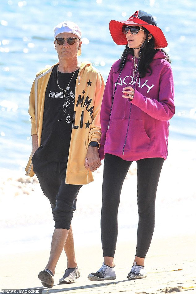 In step with one another: Liberty Ross and Jimmy Iovine were spotted strolling hand-in-hand on Thursday, looking relaxed and contemplative while they looked out over the Malibu waters