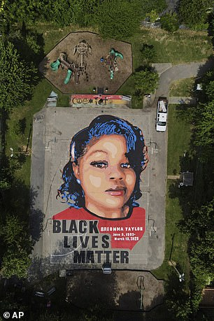 A ground mural depicting a portrait of Breonna Taylor is seen in Annapolis, Maryland on July 6