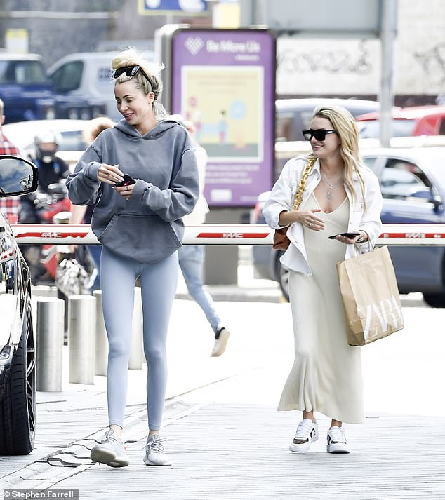 Style: Olivia donned a pair of grey gym leggings and a baggy hoodie for the trip out while Amber was chic in a slip dress and white shirt