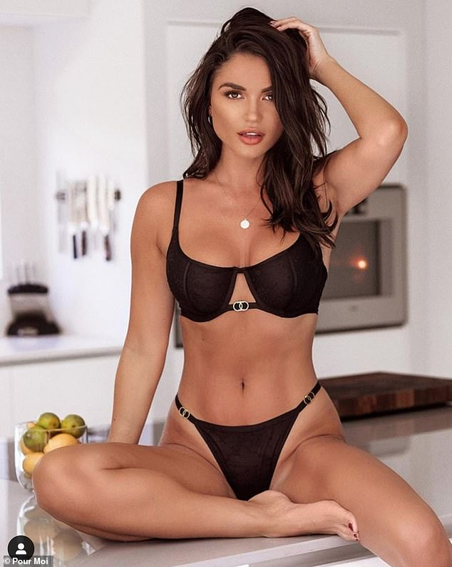 Seductive: India Reynolds debuted her toned physique and bronzed glow as she perched on a counter top for her new Pour Moi lingerie campaign that launched on Friday