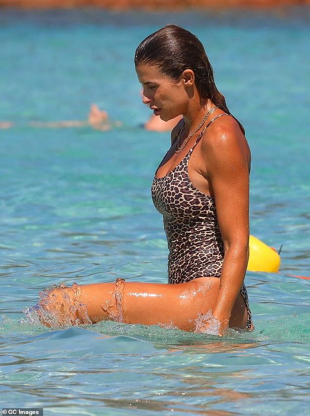 Stunning: The beauty showed off her toned and tanned figure as she cooled off in the water