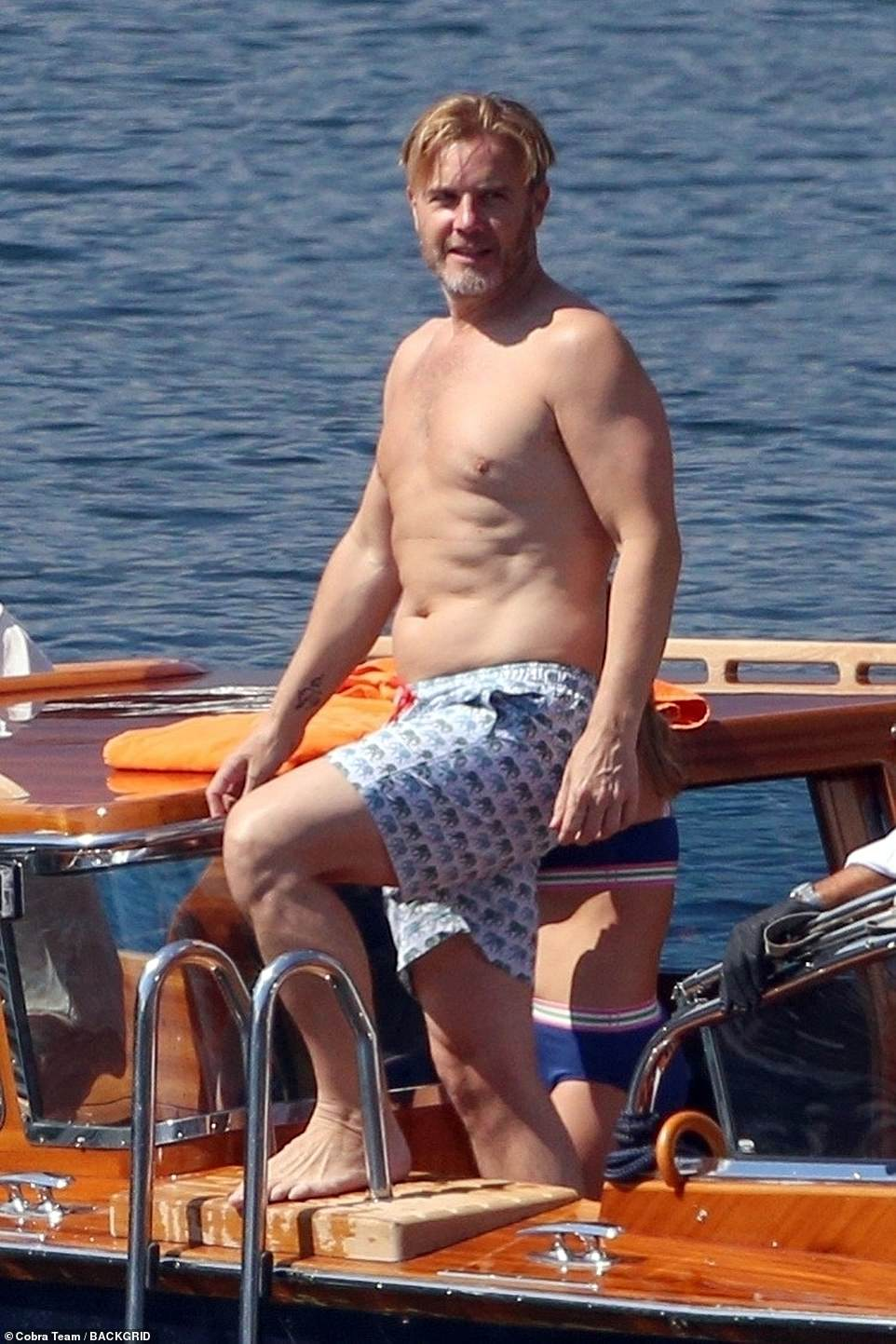 Gary Barlow, 49, and wifeDawn Andrews, 50,enjoy a swim during Lake Como trip