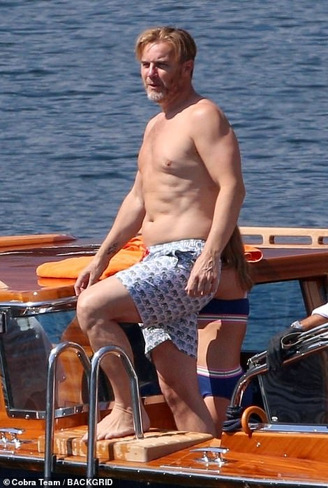 Looking good: The Take That star showed off his slim frame int he swimming trunks