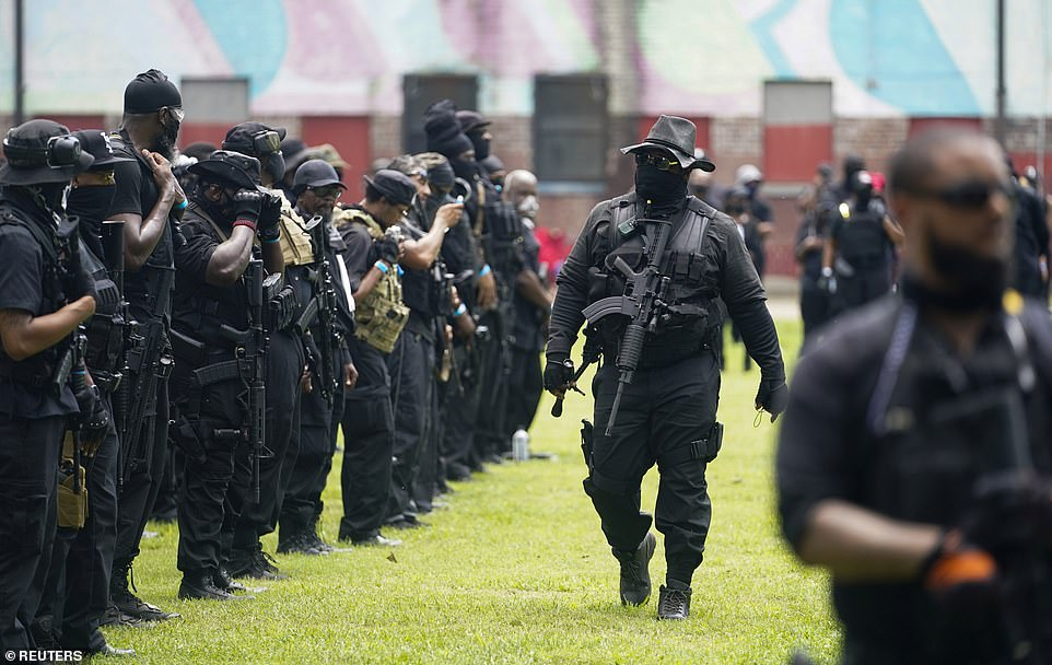 NFAC members prepare to set out on a march from their staging area in Louisville's Baxter Park on Saturday
