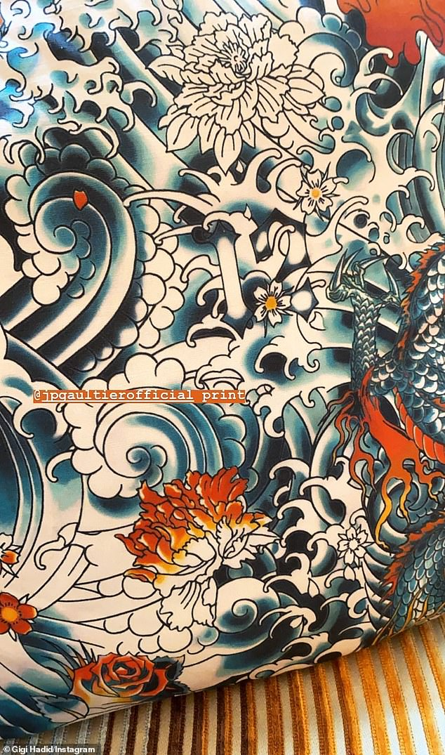 Striking:A close-up of the Jean Paul Gaultier throw pillow highlighted dragons and ocean waves in the style of a tattoo artist