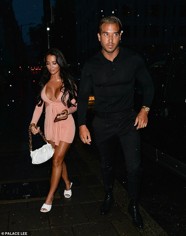Night out: Yazmin Oukhellou, 26, put on a very busty display as she enjoyed dinner with her ex James Lock, 33, at Sexy Fish in London's Mayfair on Saturday