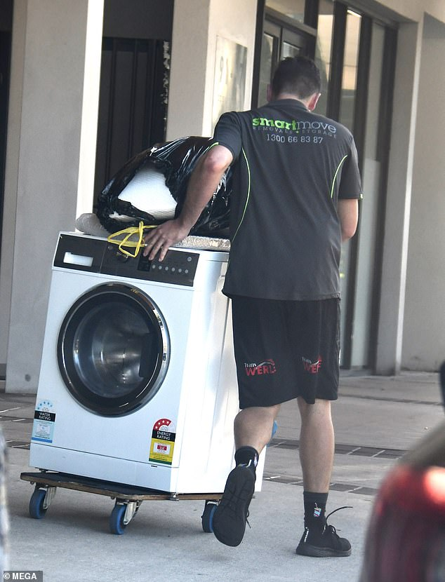 All white now: A dryer was also spotted being carted out of the property on a black trolley