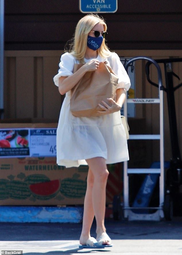 Mom-to-be: Emma Roberts glowed while out on a grocery run in Los Angeles on Saturday, in a retro-looking white smock dress with puffed sleeves