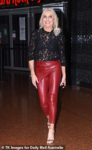 Red hot! Marissa, 61, (pictured) looked stylish wearing a long-sleeve black laced top which she paired with red leather pants