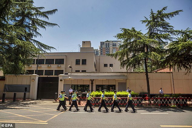 Chinese authorities took over the United States consulate in Chengdu on Monday, the foreign ministry said, days after Beijing ordered it to close in retaliation for the shuttering of its mission in Houston. Police officers march in front of the building of US consulate in Chengdu