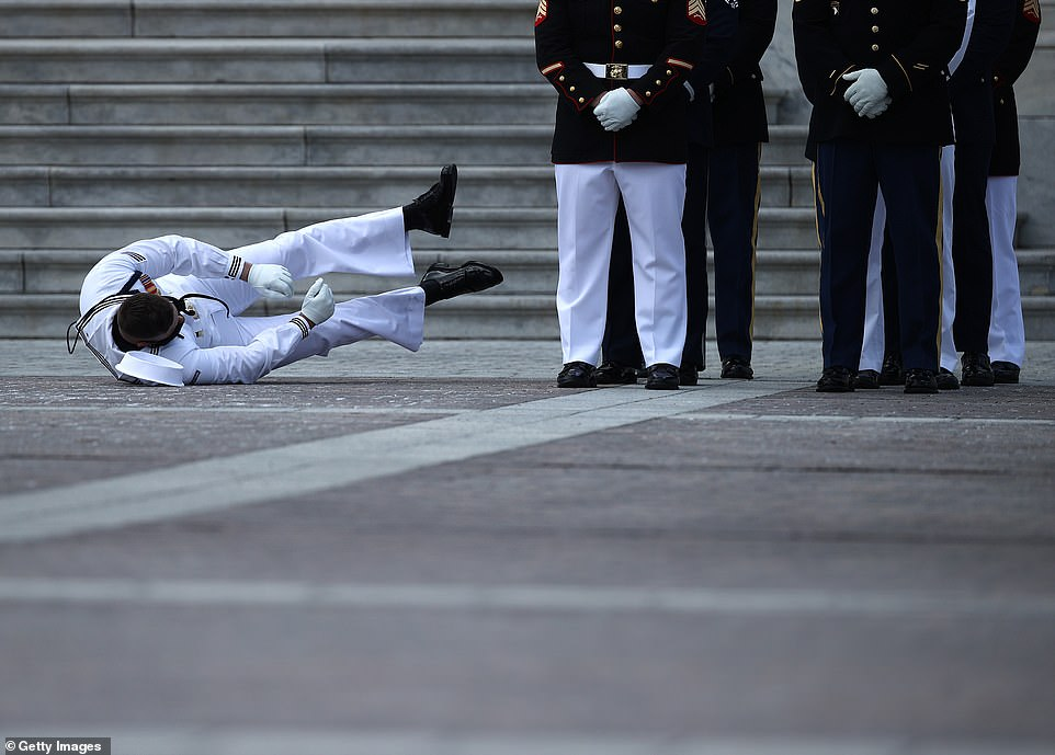 Guard of honor collapses in 96 degree heat as Rep John Lewis's coffin is taken to Capital Rotunda