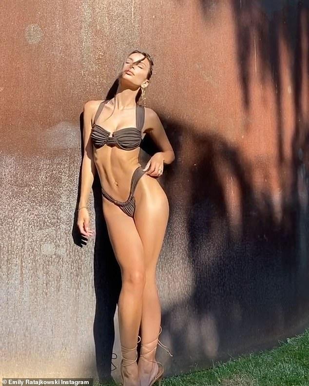 Bikini babe! Emily Ratajkowski slipped her slim frame into the skimpiest of swimsuits to showcase her upcoming Inamorata Swim satin line with new Instagram posts on Monday