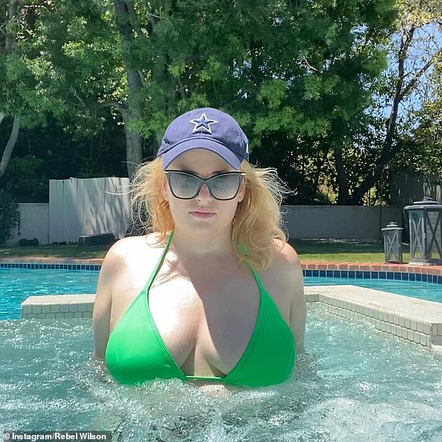 Va va voom! Last Sunday, the blonde beauty set the internet alight by uploading this sizzling Instagram photo of herself modelling a neon green bikini while relaxing in a hot tub