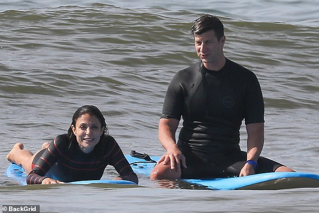 What a pair:In the water she was joined by her handsome beau Paul Bernon