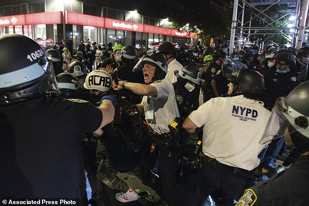 "New York Police Department officers clash with demonstrators during a ""Solidarity with Portland,"" protest in Lower Manhattan on Saturday"