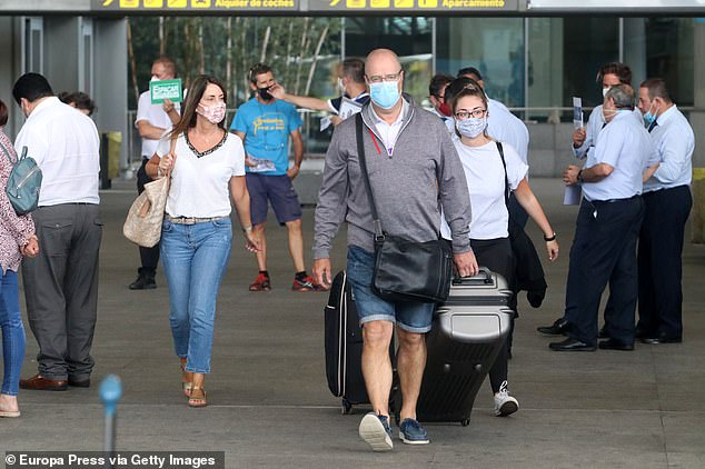 British citizens arrive at Malaga-Costa del Sol airport after the UK imposed a quarantine on all travelers from Spain