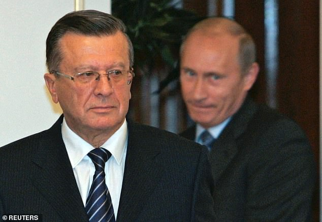 Russia's President Vladimir Putin pictured entering the hall with Prime Minister Viktor Zubkov to announce the new cabinet in Moscow in September 2007